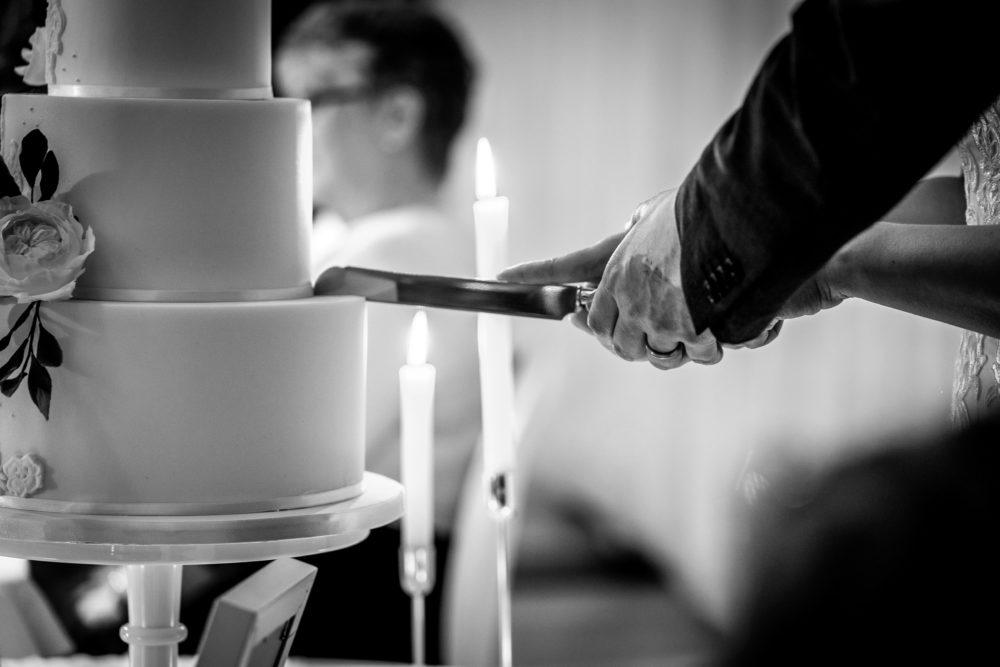 Wedding cake cutting Cove Cake Design