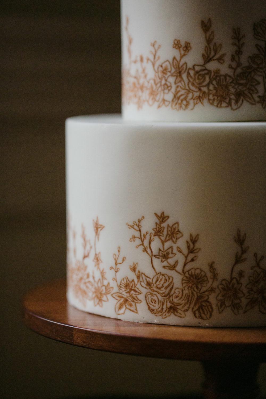 Painted wedding cake details Cove Cake Design