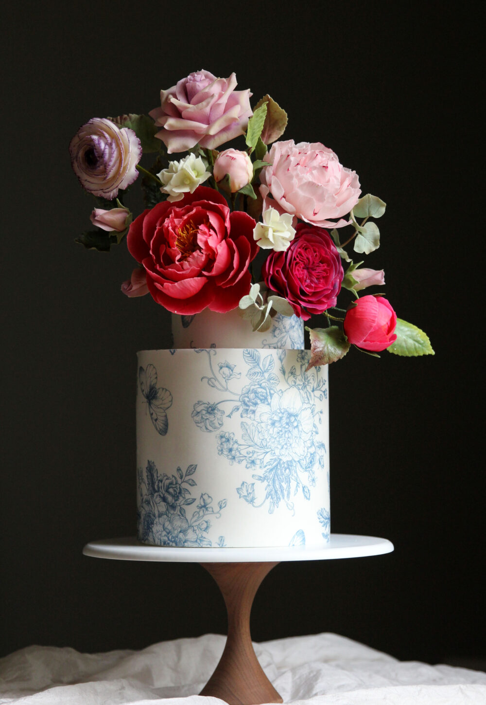 Vibrant sugar flower wedding cake Cove Cake Design