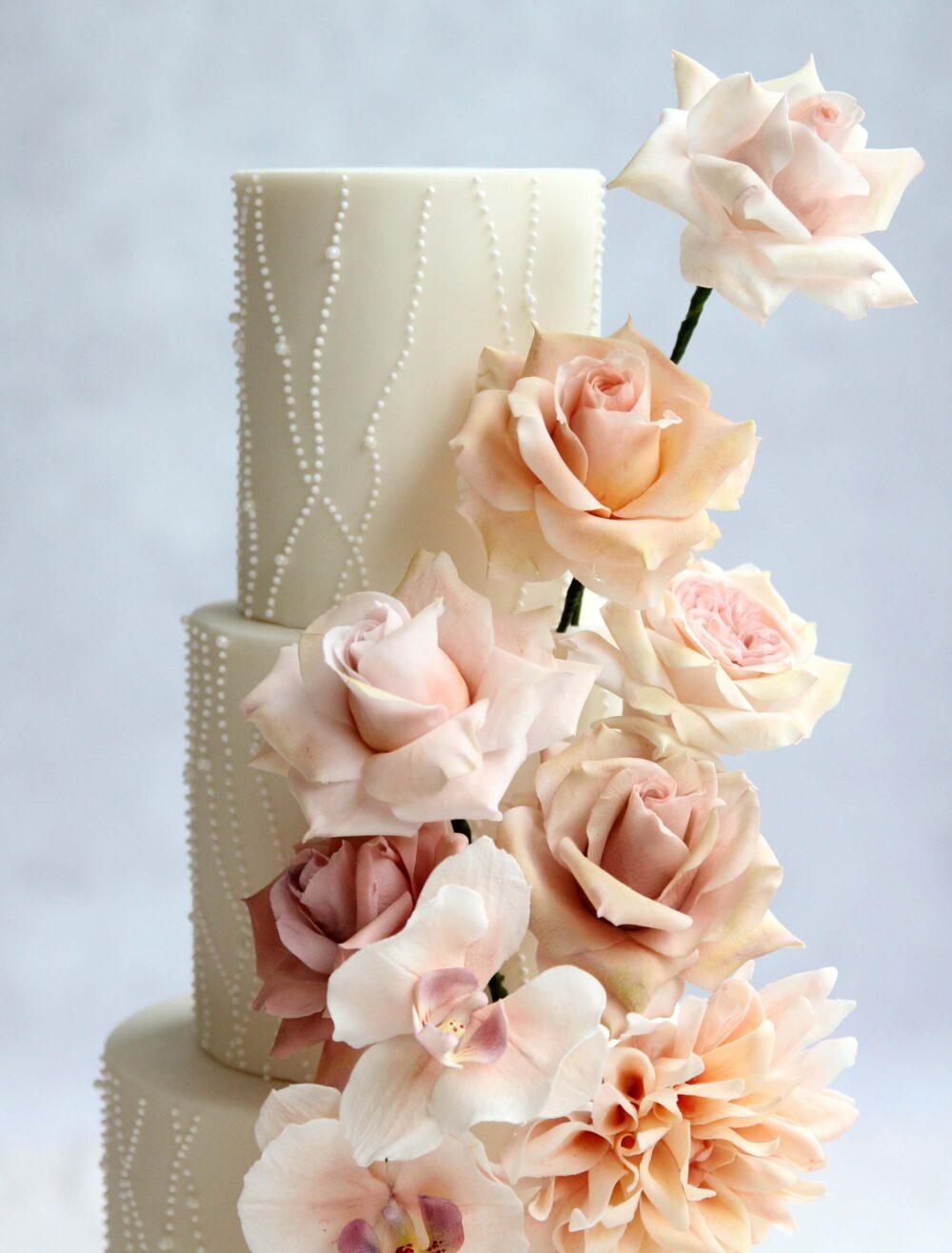 Pastel sugar flowers wedding cake Cove Cake Design
