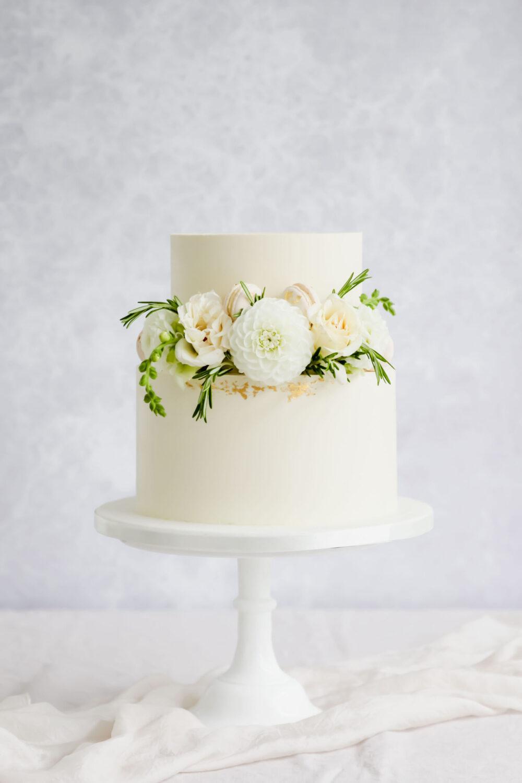 Ganache cake with edible flowers Cove Cake Design