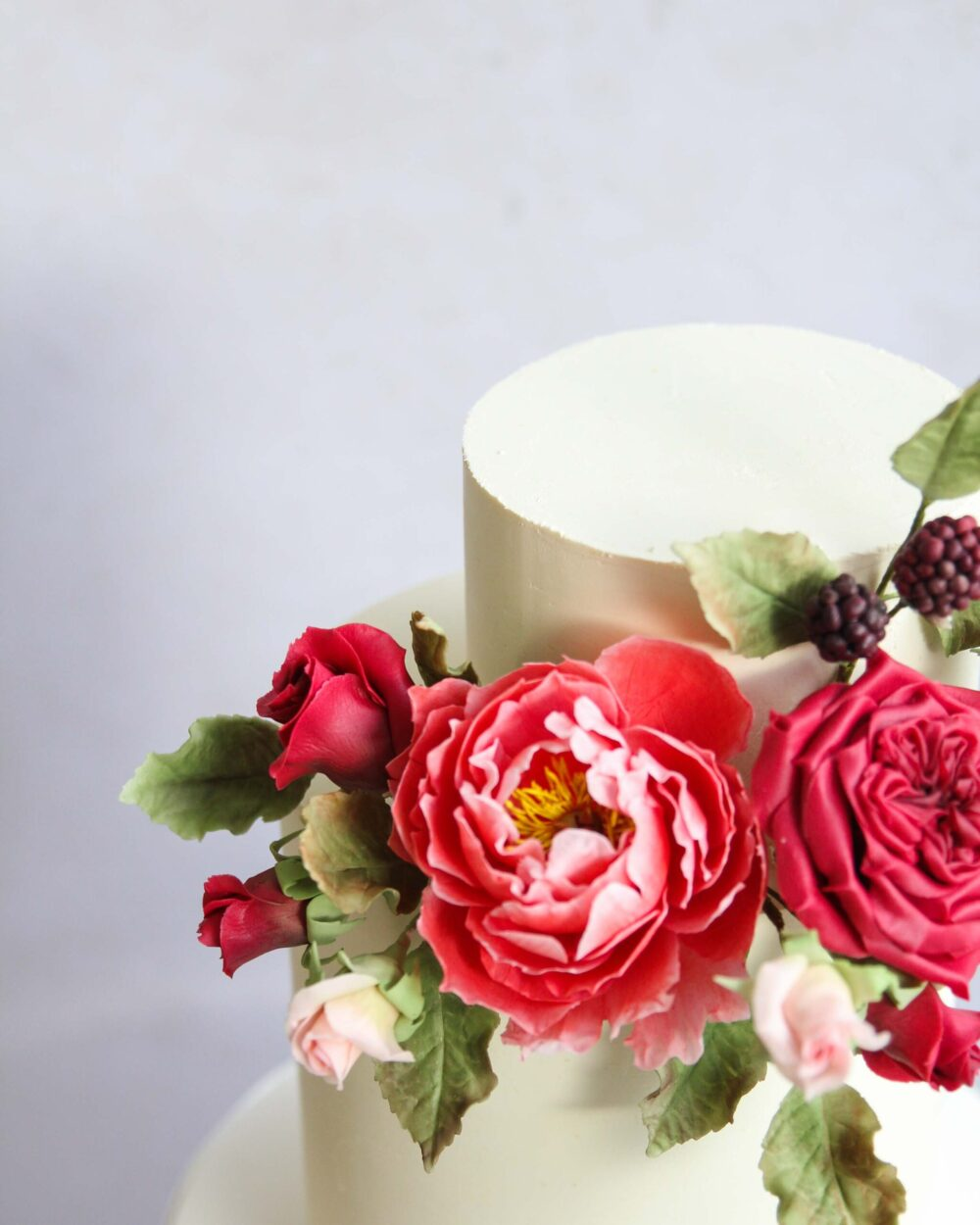 Red sugar flowers Cove Cake Design