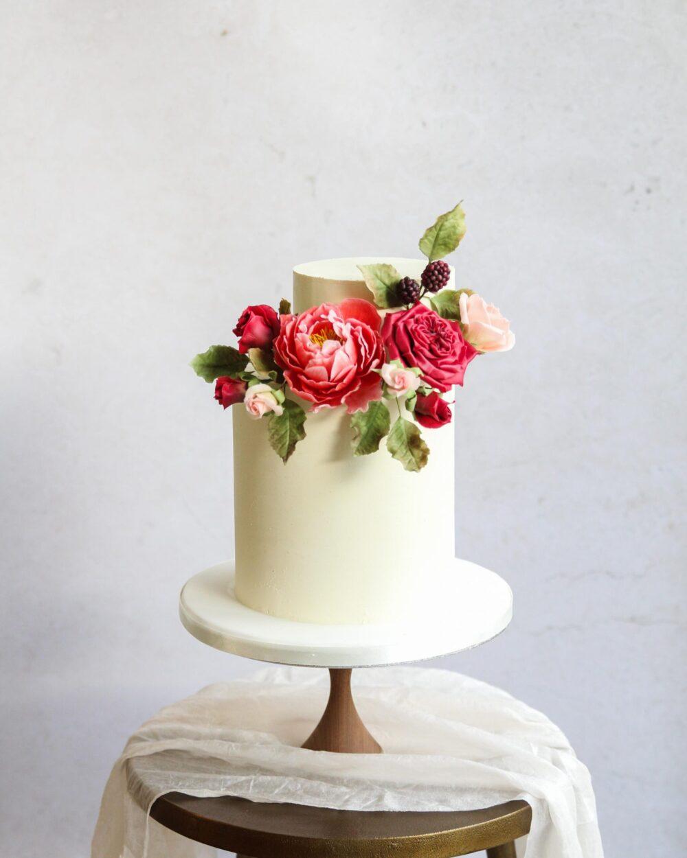 Red sugar flower wedding cake Cove Cake Design
